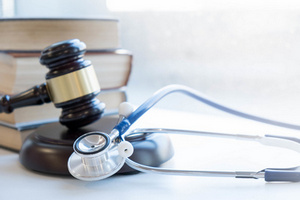 Gavel and doctor stethoscope.